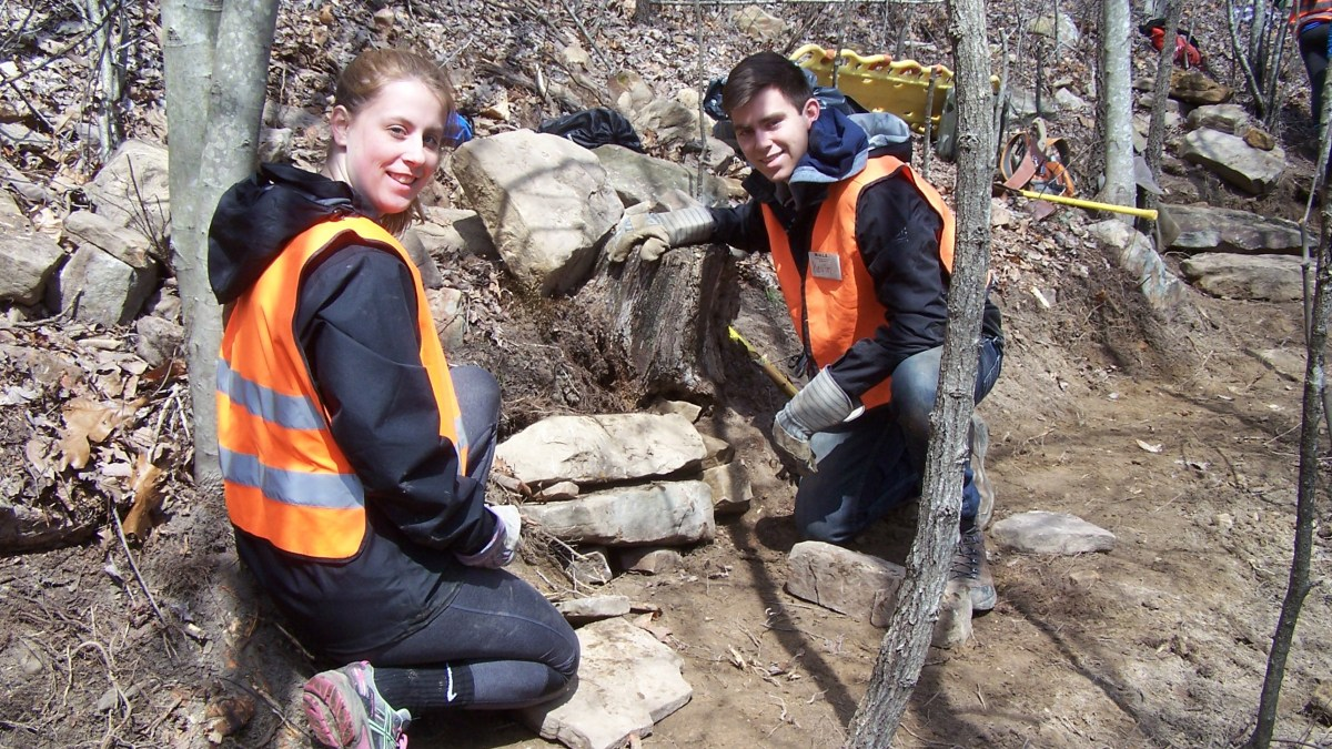 Hamilton College students pause while building a rock retaining wall on the Cumberland Trail