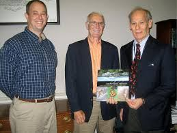 "Justin P. Wilson receives the first copy of the ""Cumberland Odyssey"" that is dedicated to him in recognition of his unparalleled support of the Cumberland Trail project"