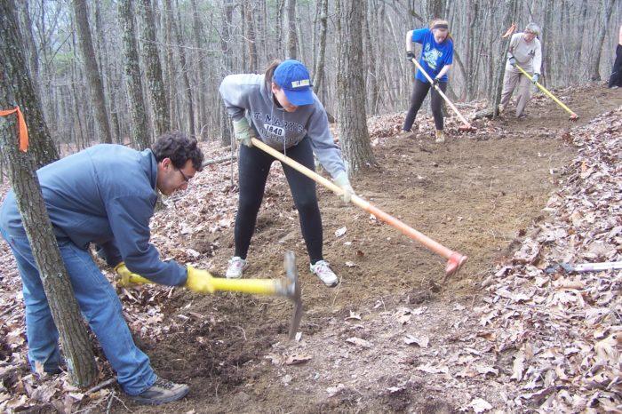 University of Delaware students work on final grooming of trail near Graysville, TN.