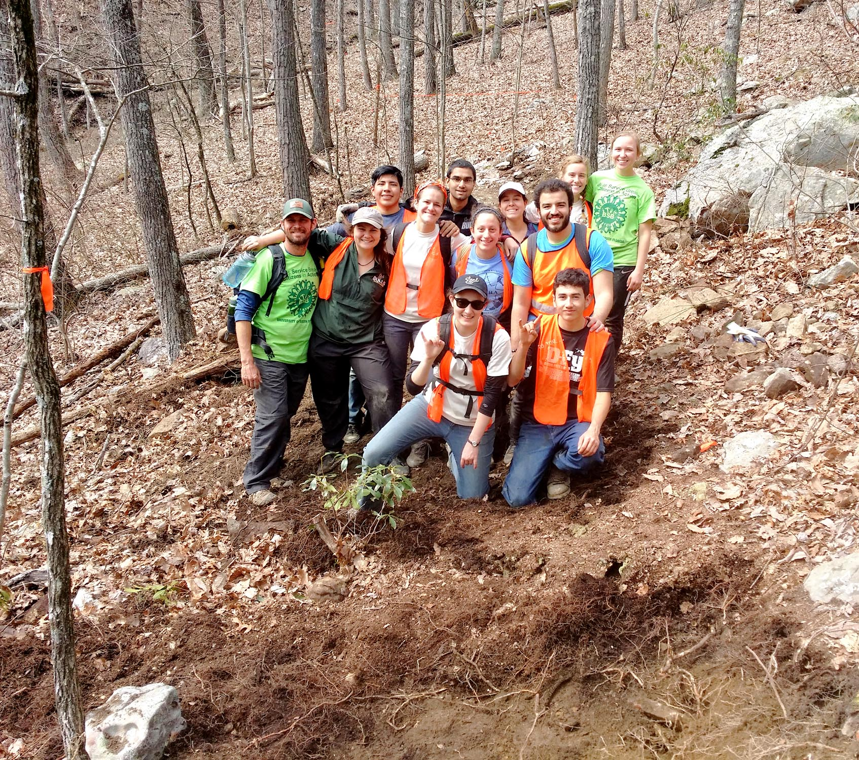 University of South Florida at the end of trail work ASB 2018, Week 2. Behind them ASB Week 3 continues to the crossing of Basin Branch in the background. (Richie)