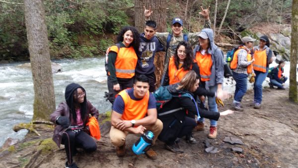 Florida International student take a moment for picture next to the roaring water of Fall Creek near Ozone Falls Tennessee. ASB 2019. (Richie)